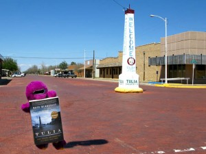 Barney with Tulia book in downtown Tulia, TX